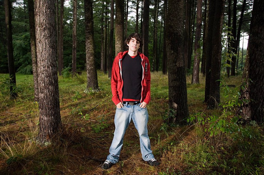 Young man standing in forest : Stock Photo