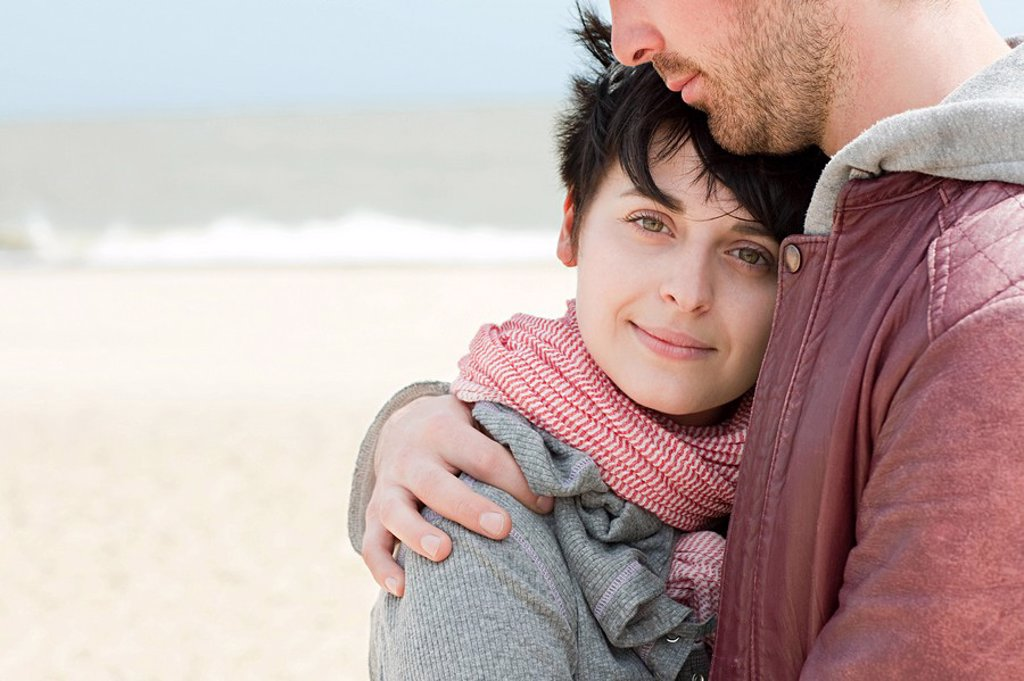 Young couple at the beach : Stock Photo