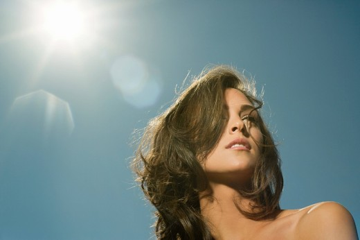 Stock Photo: 1439R-1120940 Sunlight behind a beautiful woman