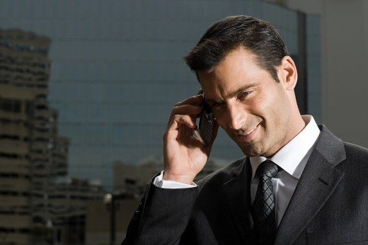 A businessman talking on a mobile phone : Stock Photo