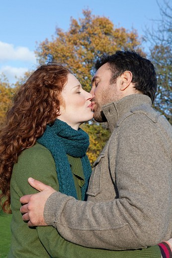 A mid adult couple kissing : Stock Photo