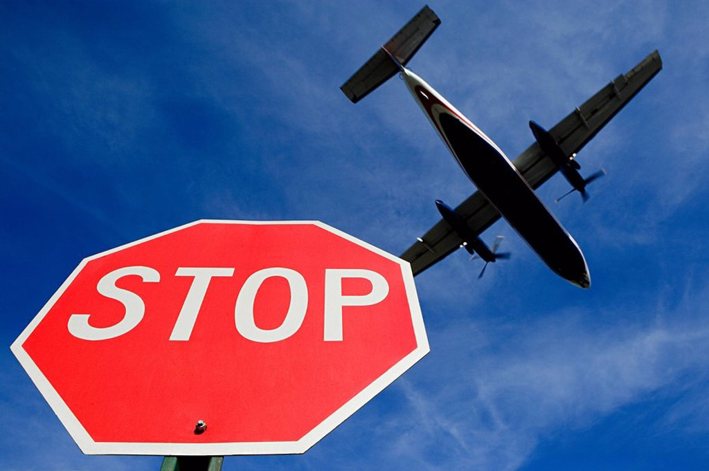 Stock Photo: 1439R-1121635 Airplane and stop sign