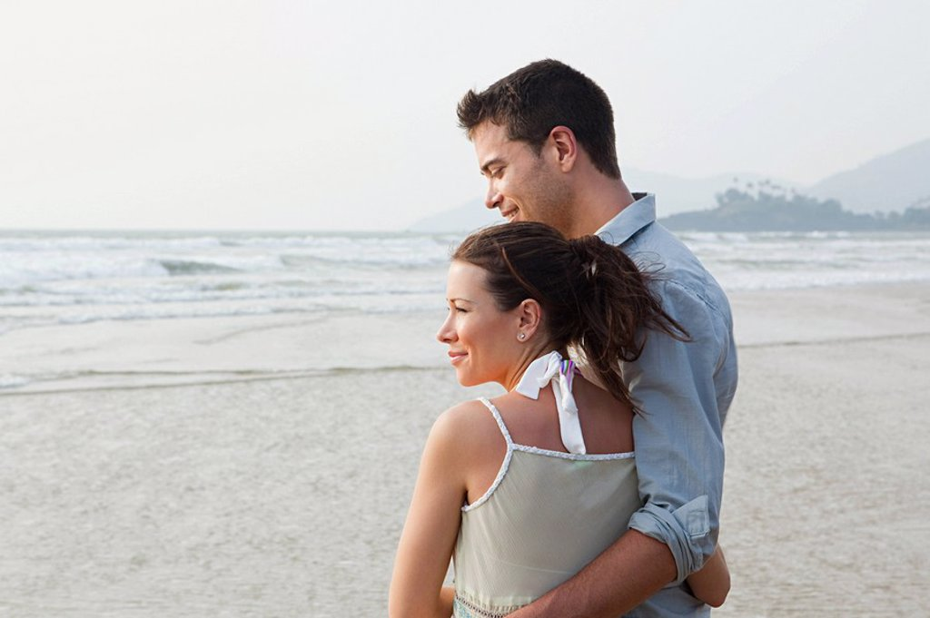 Couple by the ocean : Stock Photo