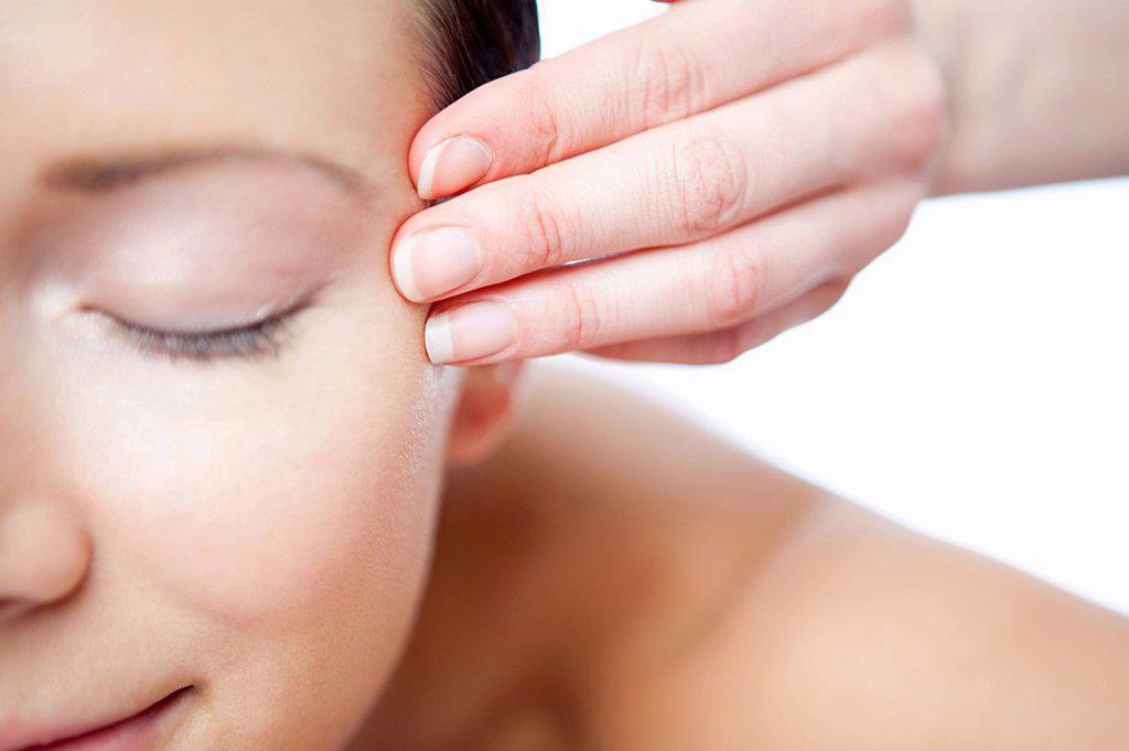 Woman having face massage : Stock Photo