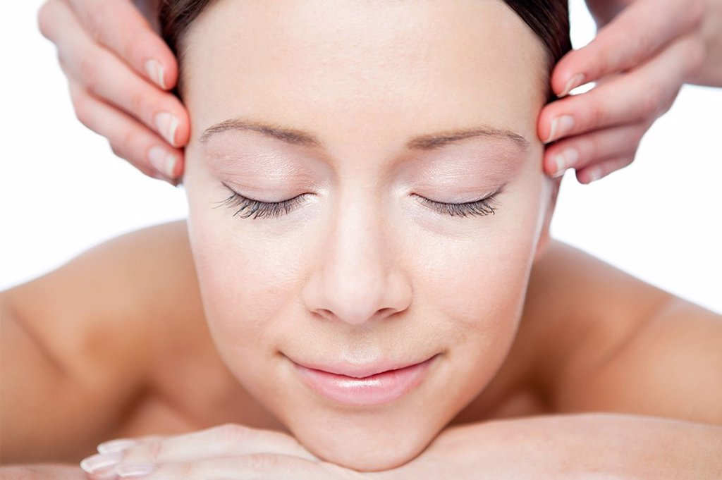 Woman having face massage : Stock Photo