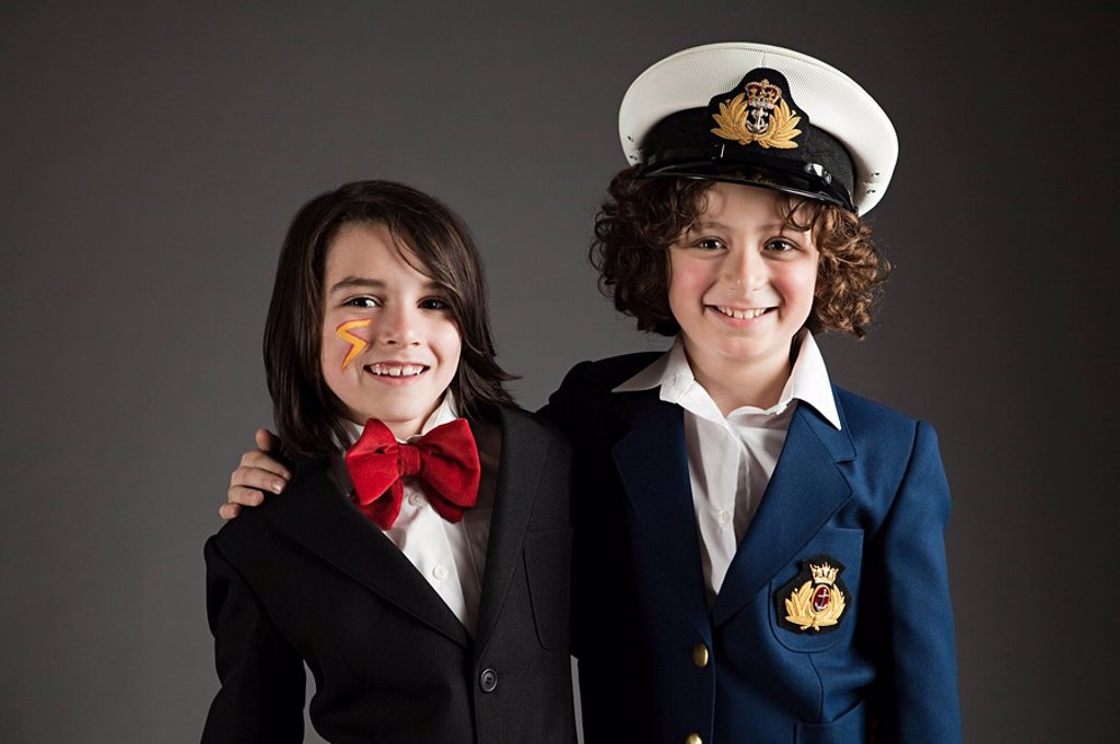 Young boys dressed up in sailor outfit and red bow tie : Stock Photo