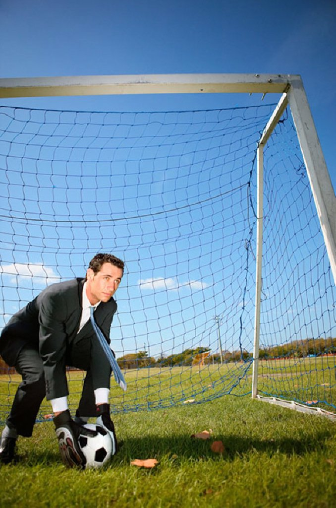 Businessman in goal : Stock Photo