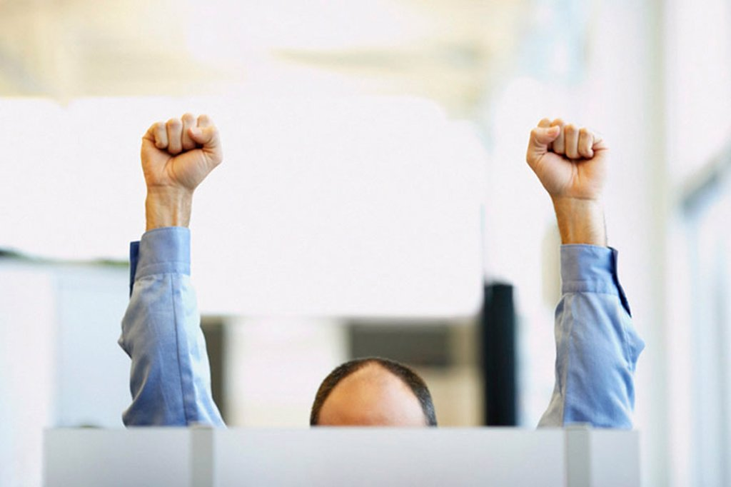 Office worker with raised fists : Stock Photo