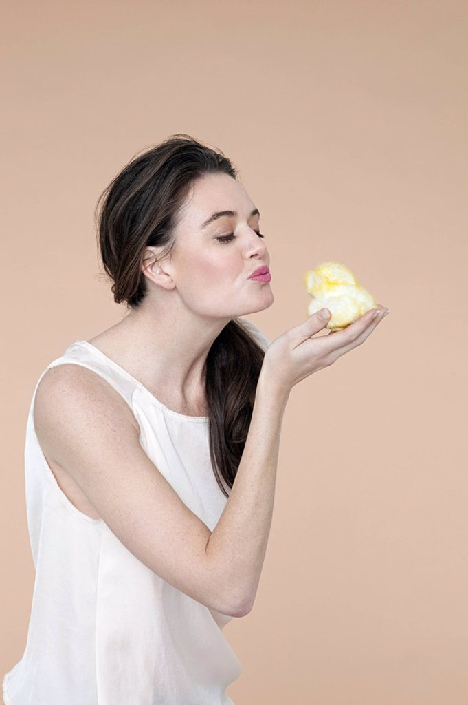 Stock Photo: 1439R-1124759 Young woman with easter chick