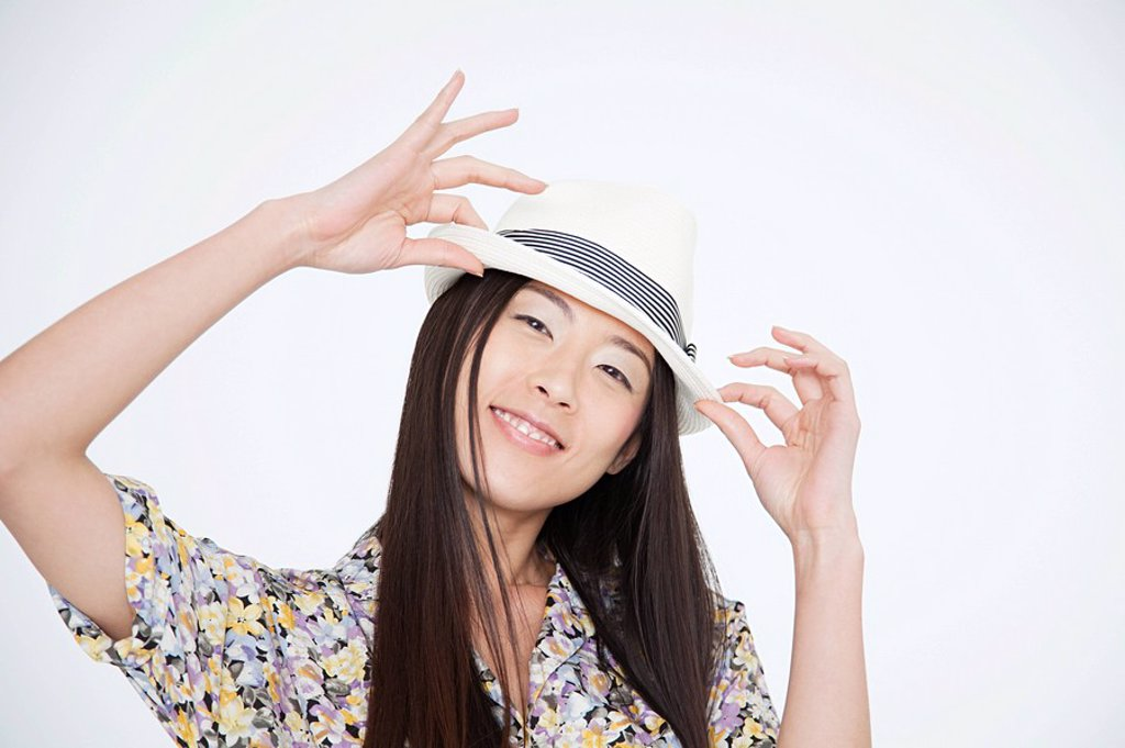 Stock Photo: 1439R-1125056 Woman wearing a trilby