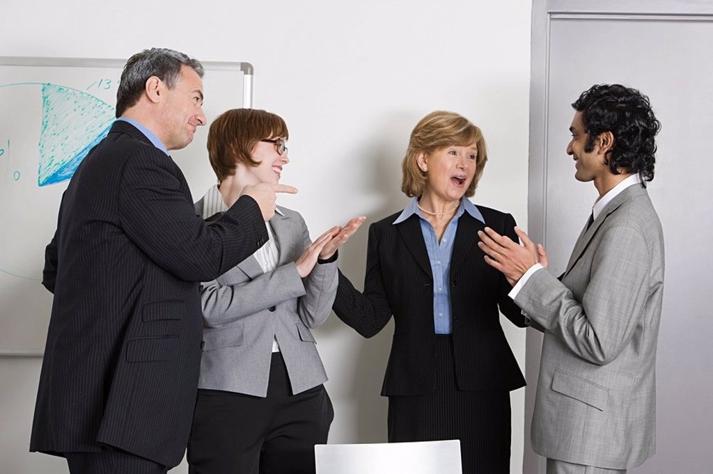 Stock Photo: 1439R-1125296 Businesspeople applauding