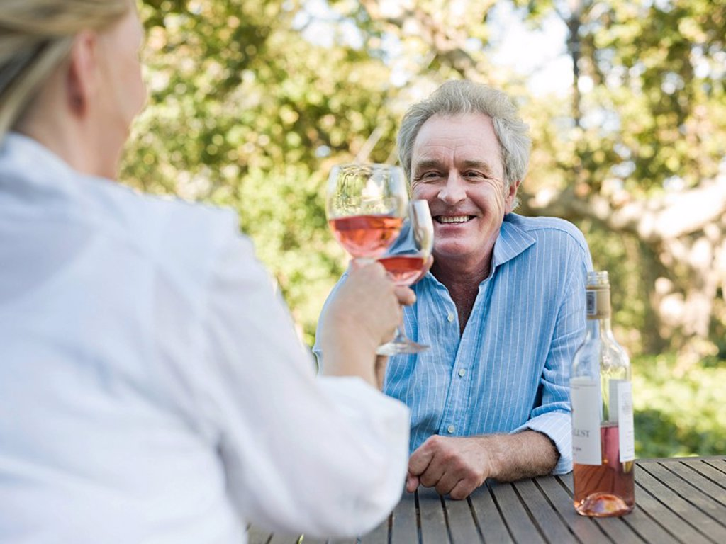 Couple toasting with wine outdoors : Stock Photo