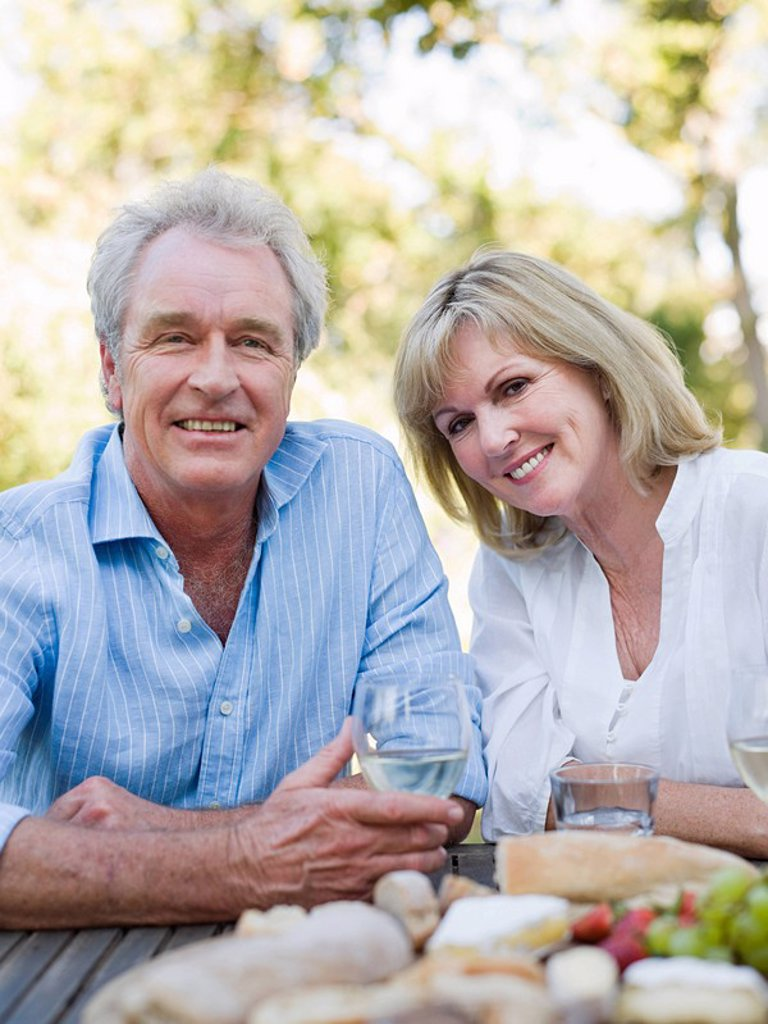 Mature couple at meal outdoors : Stock Photo