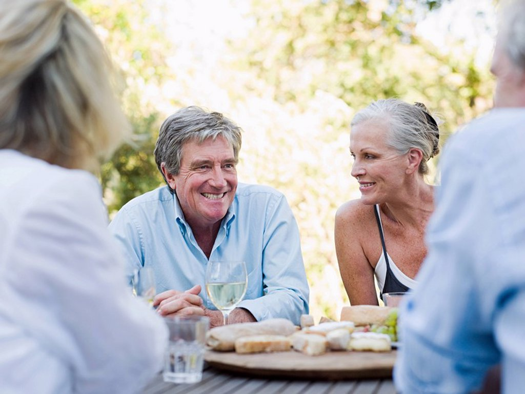 Friends at meal outdoors : Stock Photo
