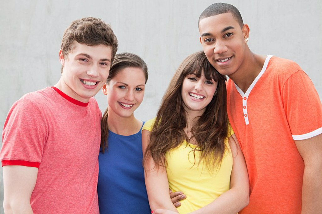Four young friends : Stock Photo
