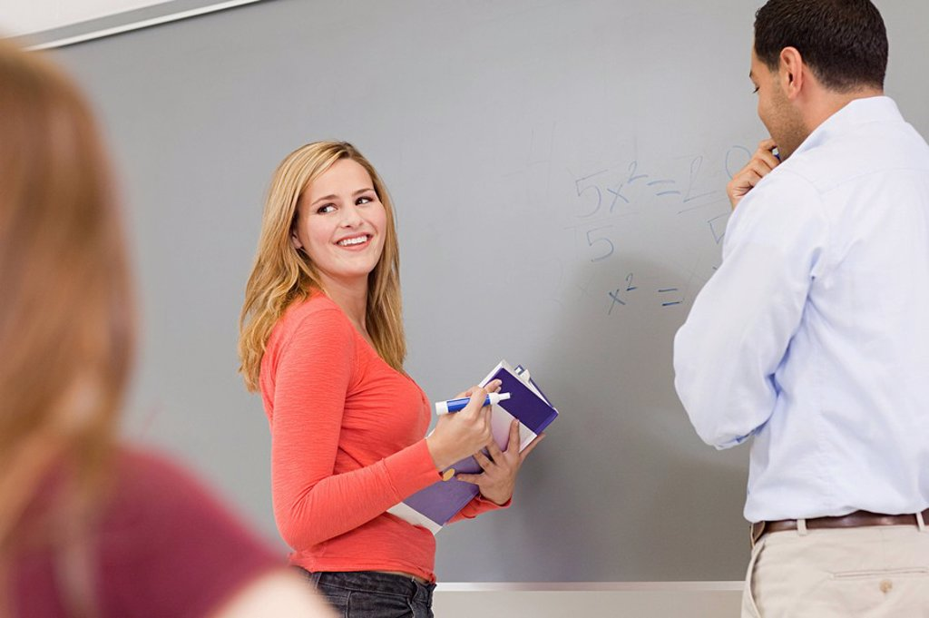 High schcool teacher and student using white board : Stock Photo