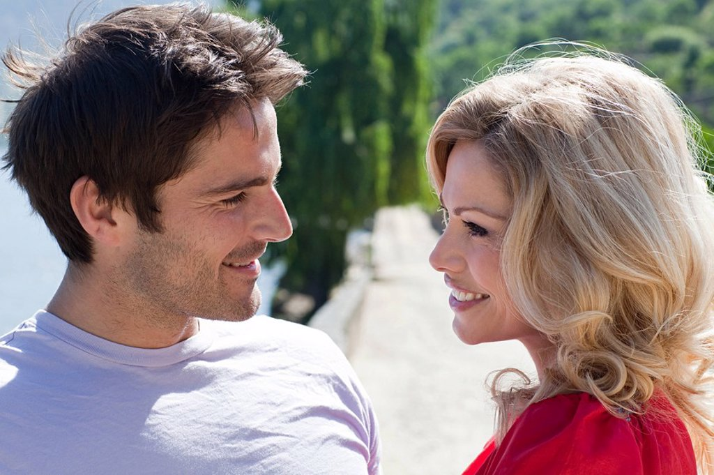 Stock Photo: 1439R-1126719 Couple face to face outdoors
