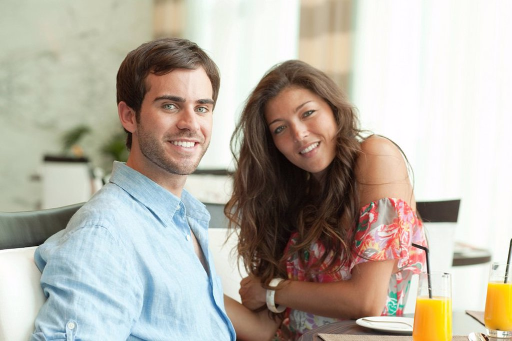 Stock Photo: 1439R-1126974 Young couple at dining table