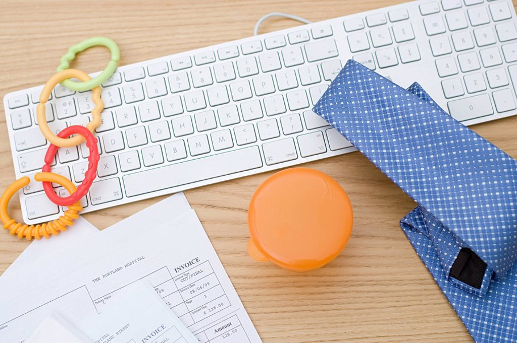 Computer keyboard with baby equipment and tie : Stock Photo