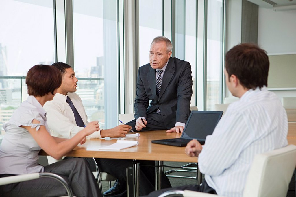 Stock Photo: 1439R-1127223 Businesspeople in meeting