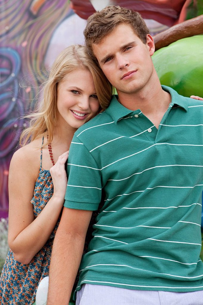 Teenage couple looking at camera : Stock Photo