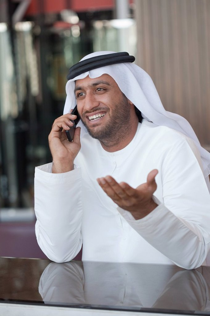 Middle eastern man on cellphone : Stock Photo