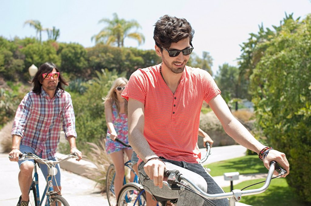 Young friends on bicycles on vacation : Stock Photo