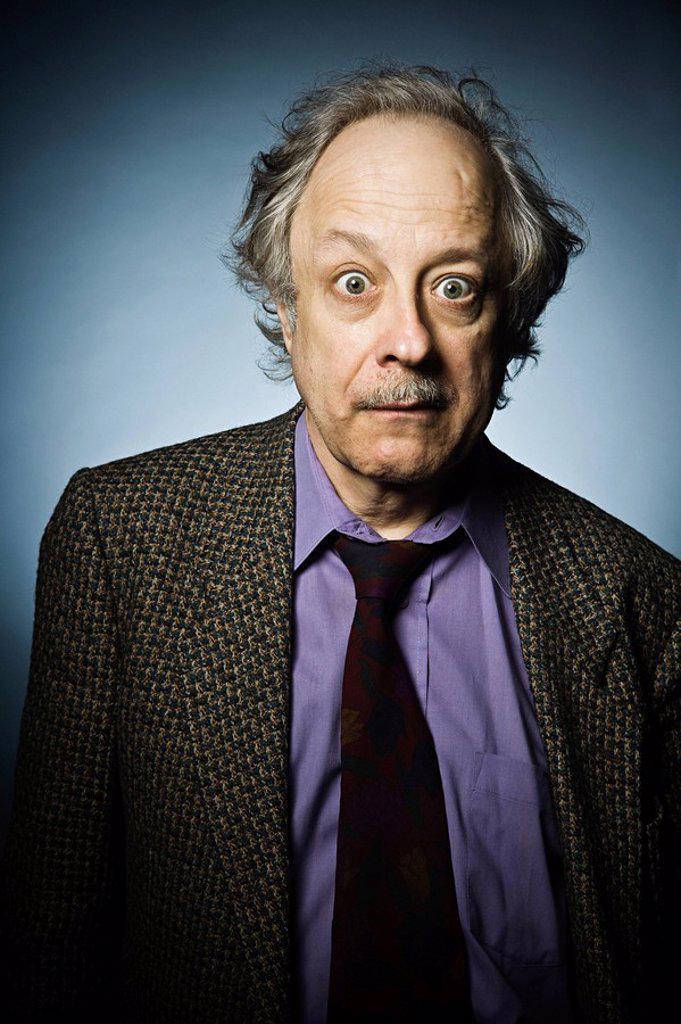 Stock Photo: 1439R-1128069 Studio portrait of surprised senior man
