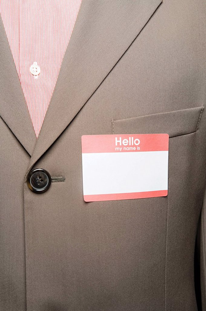 Stock Photo: 1439R-1128473 Businessman with blank name tag
