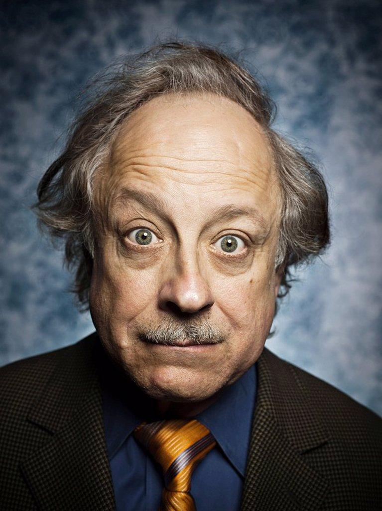 Studio portrait of surprised senior man : Stock Photo