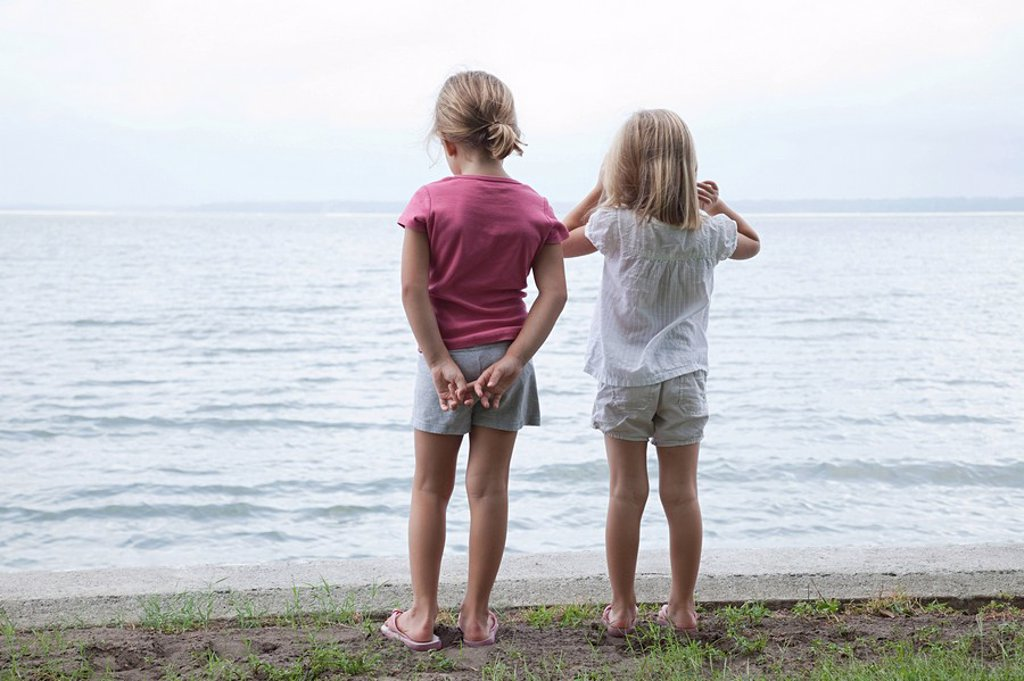 Two little girls by the sea : Stock Photo