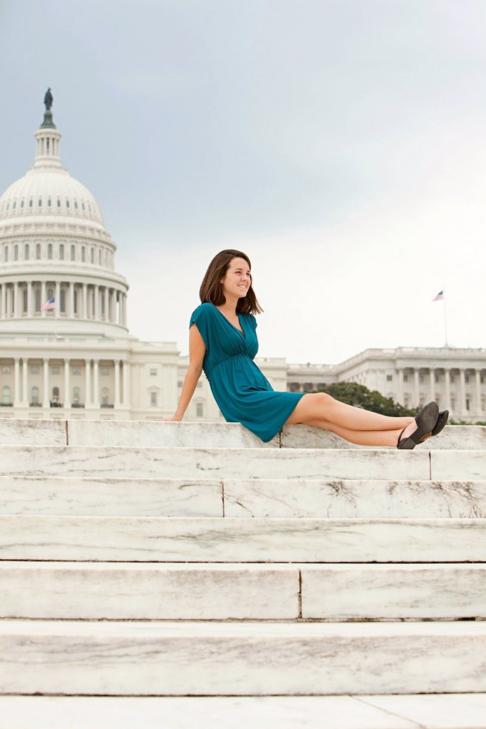 Girl on steps by united states capitol building : Stock Photo