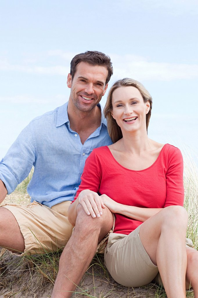 Happy couple at the coast : Stock Photo
