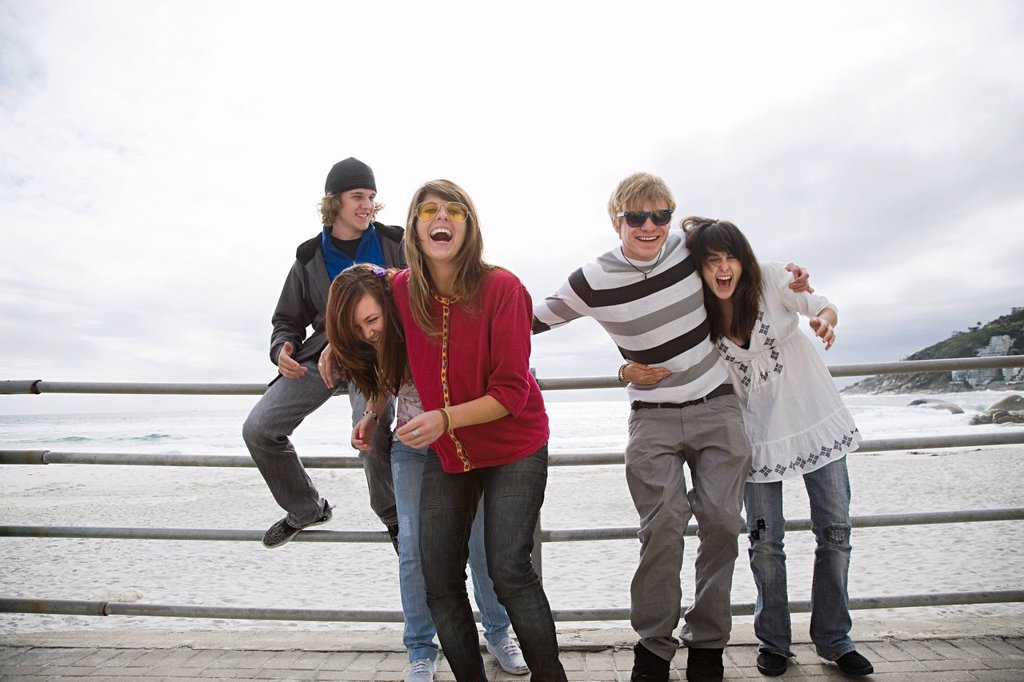 Group of friends laughing at beach : Stock Photo