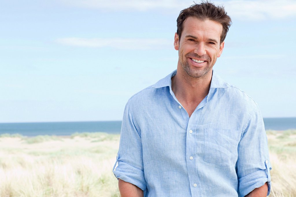 Stock Photo: 1439R-1129763 Portrait of a man at the coast