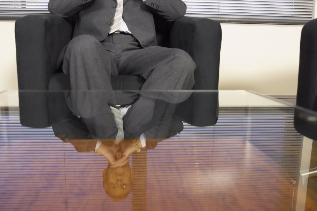 Stock Photo: 1439R-113002 Businessman reflected in glass table