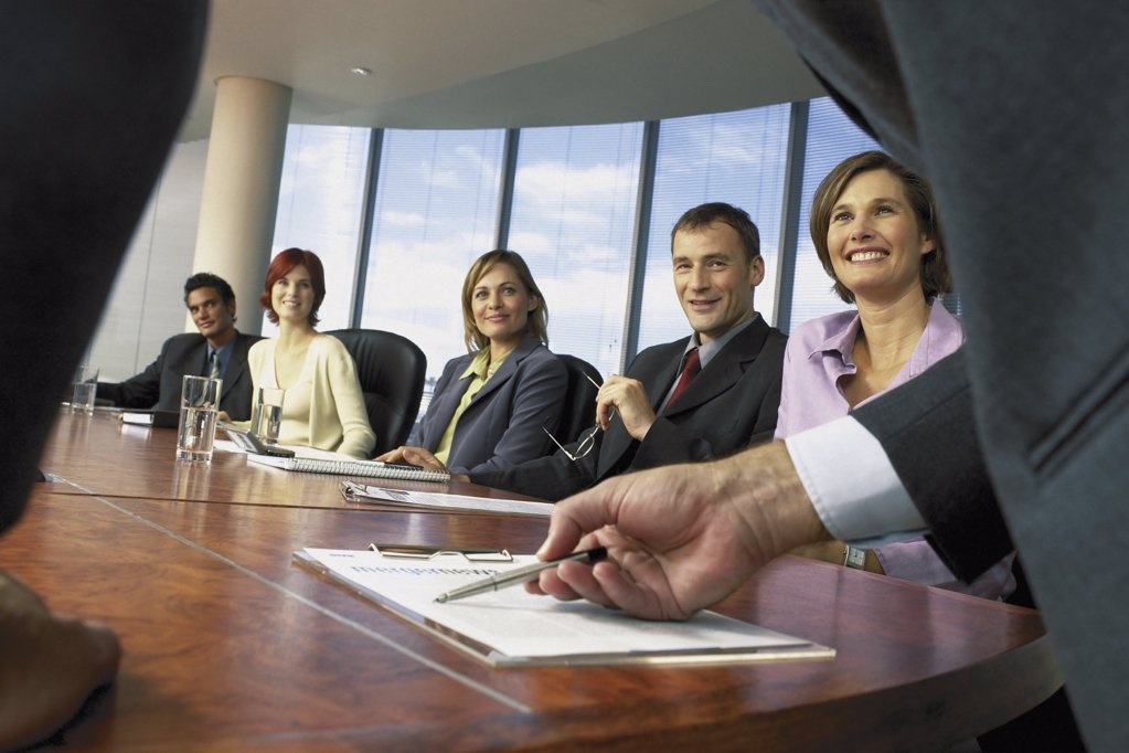 Stock Photo: 1439R-113010 Businesspeople in boardroom
