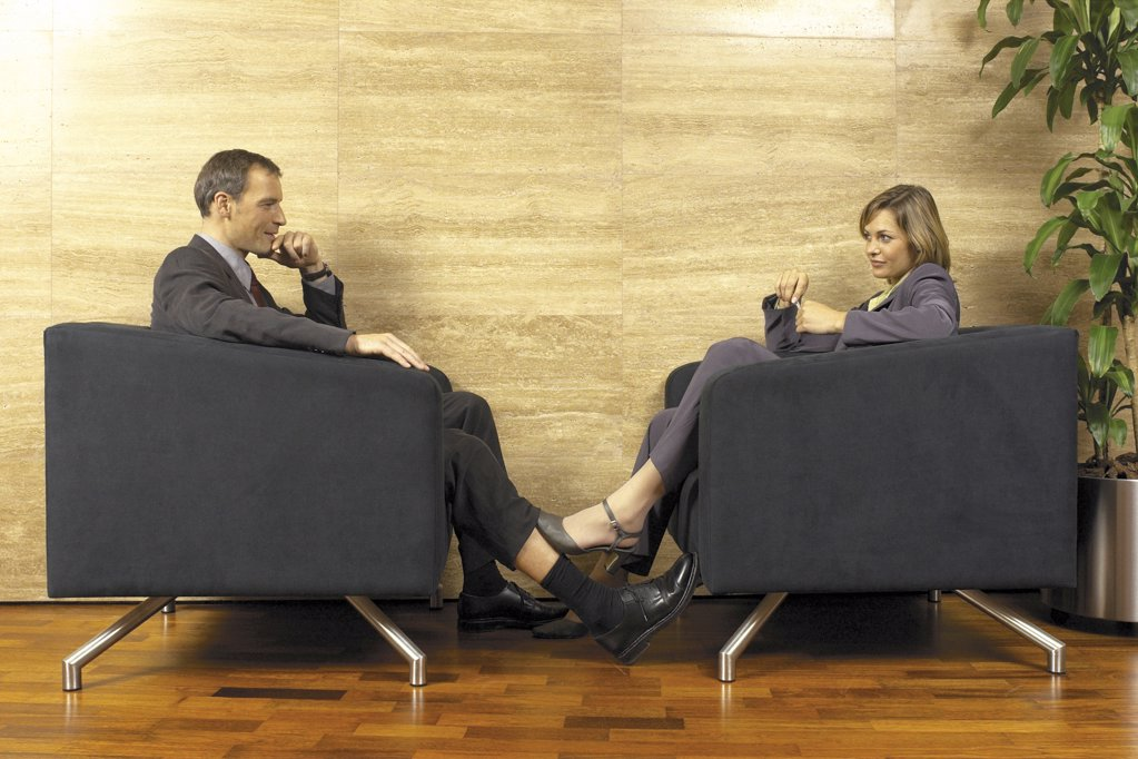 Stock Photo: 1439R-113020 Businessman and businesswoman flirting
