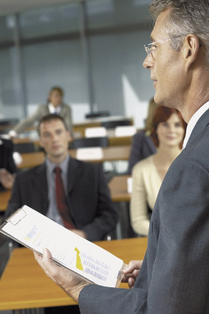 Stock Photo: 1439R-113024 Businesspeople being lectured