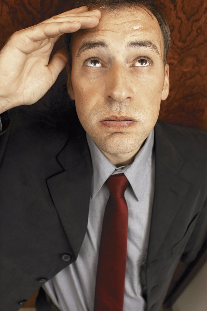 Businessman looking upwards : Stock Photo