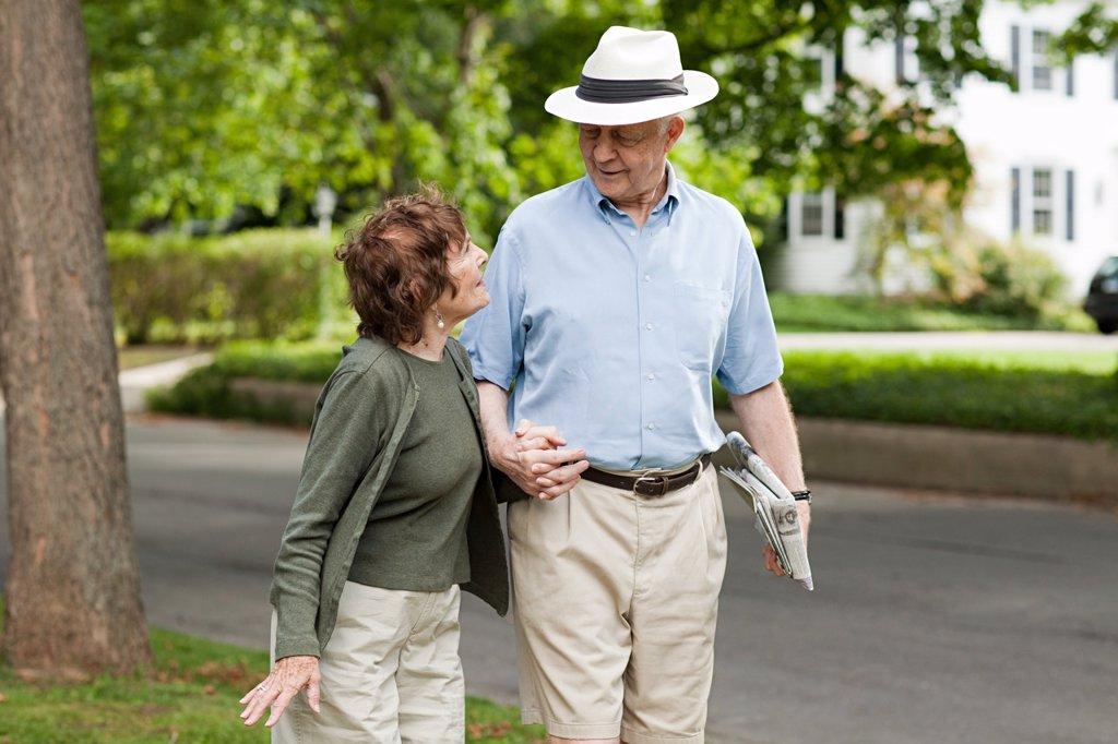 Stock Photo: 1439R-1130434 Senior couple in neighborhood