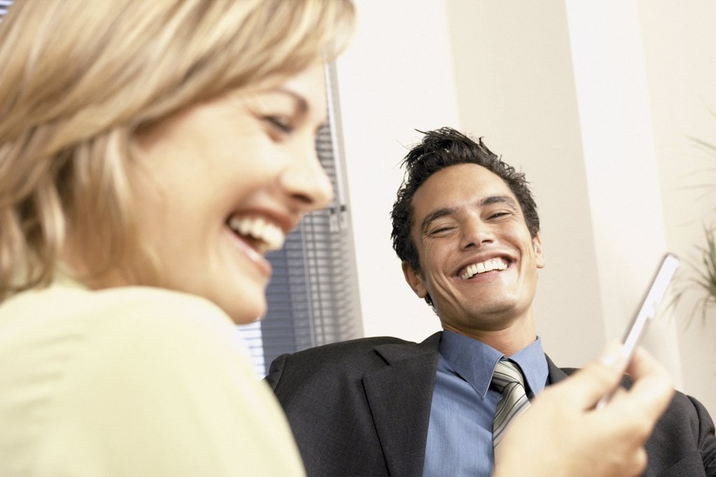 Businessman and businesswoman joking : Stock Photo
