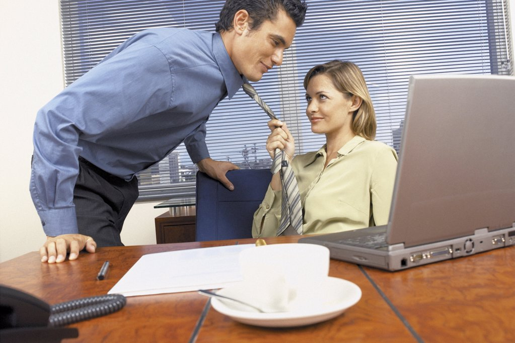 Businessman and businesswoman flirting : Stock Photo