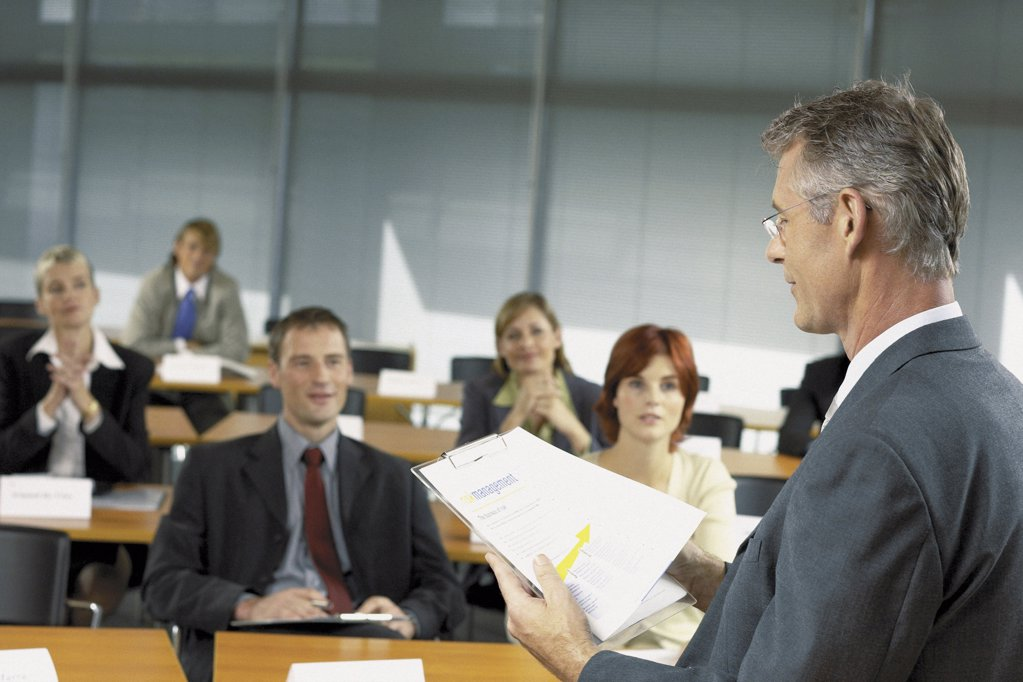 Stock Photo: 1439R-113086 Businesspeople being lectured
