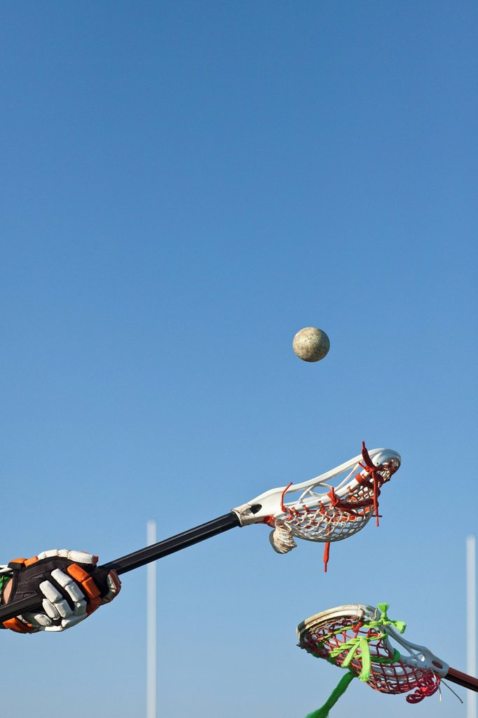 Lacrosse players competing for the ball : Stock Photo