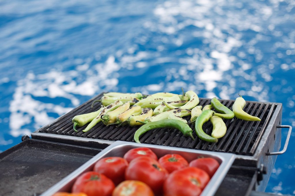 Stock Photo: 1439R-1131234 Vegetables on bbq on boat, Oludeniz, Turkey