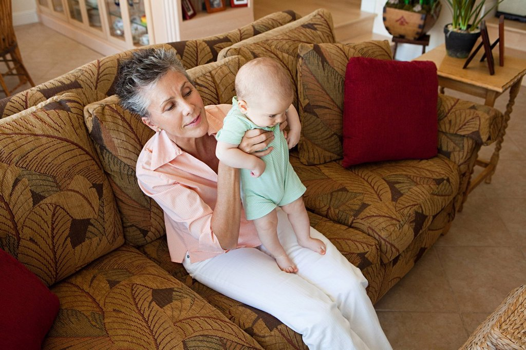 Stock Photo: 1439R-1131550 Senior woman with baby grandson
