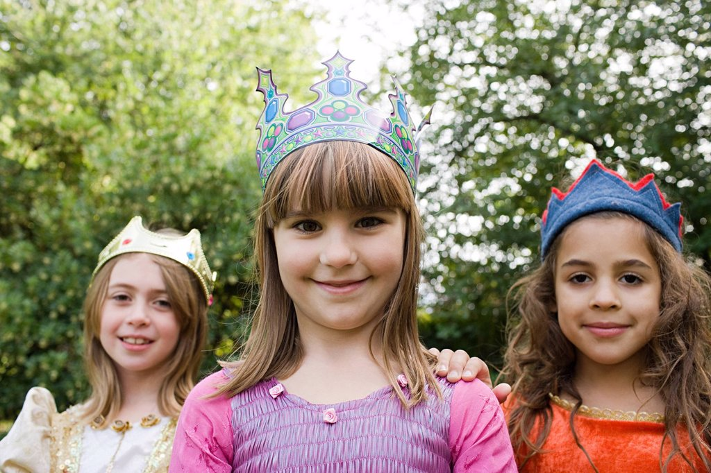 Girls wearing crown dressed up as queens : Stock Photo