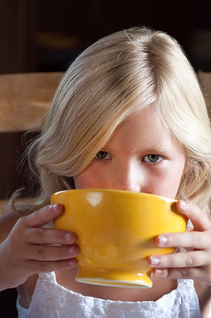 Girl with hot drink in bowl : Stock Photo