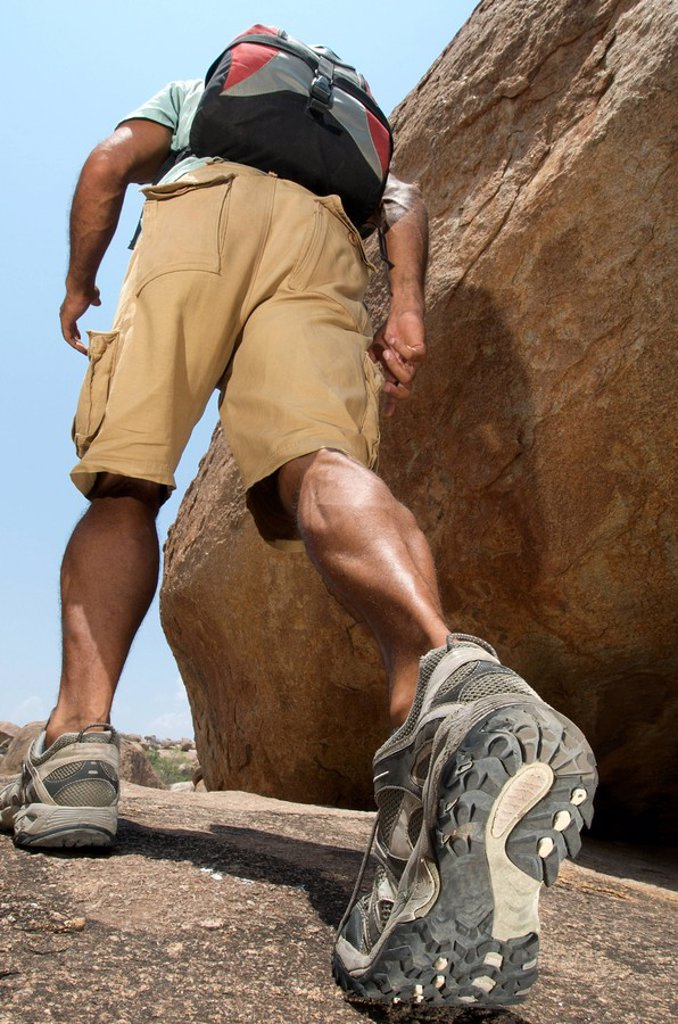 Stock Photo: 1439R-1132568 Man hiking in rocky terrain